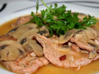 Schweinefleisch mit Champignons